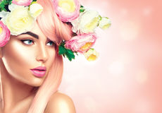 Blooming flowers wreath on woman`s head Stock Photos