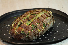 Blooming onion bread. With cheese, butter and green onion on a baking dish Stock Images