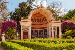 Blooming Pavilion. Pavilion with blooming flowers and bushes in the Palermo City Park Stock Photos