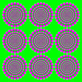 Blooming pink wheels motion illusion. It seems the wheels with magenta dots on green background become bigger when moving the eyes from one to another Royalty Free Stock Photo