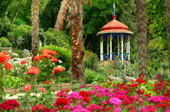 Blooming summer garden and gazebo Royalty Free Stock Photo