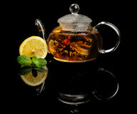 Blooming tea. Blooming or flowering tea on black reflecting background Stock Photos