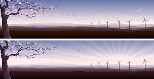 Blooming tree and several wind turbines Stock Photos