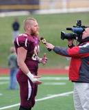 Bloomsburg tight end and senior captain Ben Weaber. BLOOMSBURG, PA - NOVEMBER 6: Bloomsburg tight end Ben Weaber (#88) is interviewed on TV following a 61-35 win stock photography