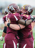 Bloomsburg touchdown celebration. BLOOMSBURG, PA - NOVEMBER 6: Bloomsburg running back Franklyn Quiteh (#28) and lineman Pat Casey (#74) celebrate Quiteh's royalty free stock image