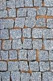 Bloque de piedra vertical detallado grande del fondo de la textura del pavimento del guijarro del granito que pavimenta a Grey Pa Fotos de archivo