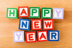Bloque del juguete de la Feliz Año Nuevo Fotos de archivo libres de regalías