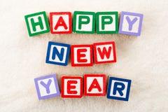 Bloque del juguete de la Feliz Año Nuevo Imágenes de archivo libres de regalías