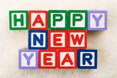 Bloque del juguete de la Feliz Año Nuevo Imagenes de archivo