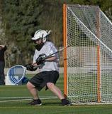 Bloque del portero del lacrosse de los muchachos Foto de archivo libre de regalías