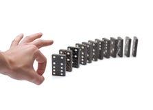 bloque la poussée de personne de domino Photo stock