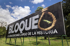 Bloqueo. Billboard depicting the embargo against Cuba like the biggest genocide in history, Havana, Cuba Royalty Free Stock Images