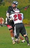 Bloqueo del lacrosse de los muchachos Fotografía de archivo libre de regalías