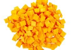 Bloques anaranjados de la calabaza en el fondo blanco Foto de archivo libre de regalías