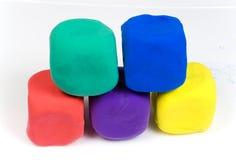 Bloques coloreados de la arcilla imagenes de archivo