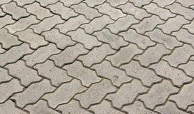 Bloques de bloques de piedra grises para pavimentar las aceras Fotos de archivo