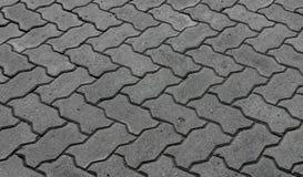 Bloques de bloques de piedra grises para pavimentar las aceras Fotografía de archivo