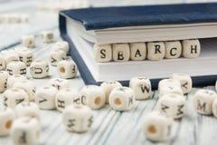 Bloques de madera con la búsqueda de la palabra ABC de madera Fotografía de archivo libre de regalías