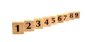 Bloques de madera de la fila con números Foto de archivo libre de regalías