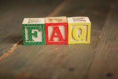 Bloques de madera del FAQ Foto de archivo