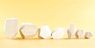 Bloques de madera en una fila Imágenes de archivo libres de regalías