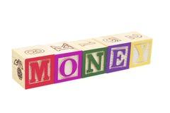 Bloques del alfabeto - dinero foto de archivo