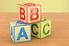 Bloques del juguete, cubos del ABC en la tabla de madera representación 3d stock de ilustración
