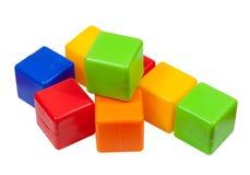Bloques plásticos del juguete en blanco Foto de archivo