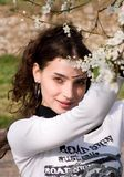 Blossom. Young woman smelling blossom tree flowers Stock Photos