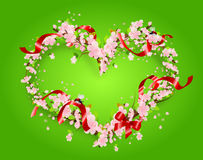 Blossom heart on green background with red ribbon Stock Images