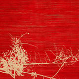 Blossom silhouette on red ribbed handmade paper Stock Photography
