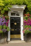 Blossoming flowers and georgian entrance, Henley on Thames Stock Images