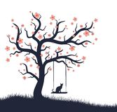 Blossoming tree with swing and cat. Royalty Free Stock Image