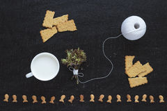 Blossoming twigs, milk, cotton skein and cookies Royalty Free Stock Photos