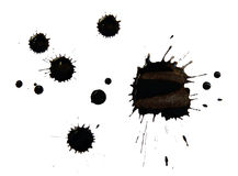Blots of black ink. On white paper royalty free stock images