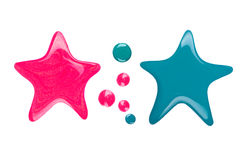 Blots or drips of nail polish in the form of star. On white background royalty free stock photo