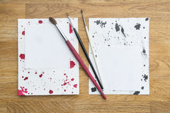 Blots of ink. With different brushes on a white paper royalty free stock photography