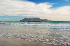 Bloubergstrand beach. Scenic view of Bloubergstrand beach with Table Mountain in background under cloudscape, Table Bay, South Africa Stock Photos