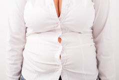 Blouse don`t fit on plus sized woman Stock Photography