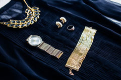 Blouse with gold accessories stock images