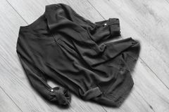 Blouse on wooden floor Royalty Free Stock Image