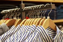 Blouses on a hanger in boutique of women`s clothes royalty free stock photos