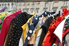 Blouses on hangers. Colorful blouses on hangers on an open air second hand market Royalty Free Stock Photos