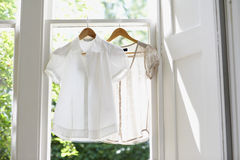 Blouses On Hangers At Home Stock Photos