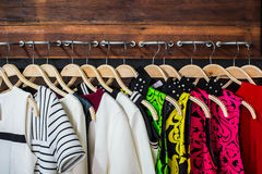Blouses. Many blouses on hangers in the dressing room stock photography