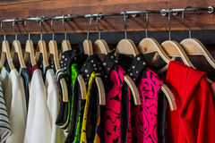 Blouses. Many blouses on hangers in the dressing room royalty free stock photos