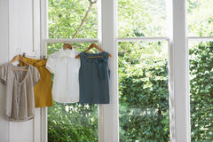 Blouses And Skirt On Hangers At Home Stock Photography