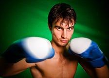 Blow of the boxer Stock Photos