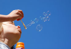 Blow Bubbles. Young Girl makes Blow Bubbles Royalty Free Stock Images