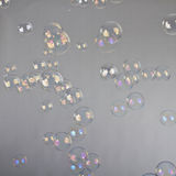 Blow bubbles. Over a studio background. Lots of them royalty free stock photos